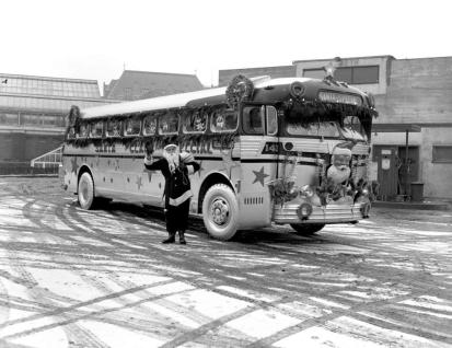"""Vancouver Island Coach Lines Christmas Bus; Crystal Gardens In The Background."" [1951]. Image I-02458/RBCM&A"