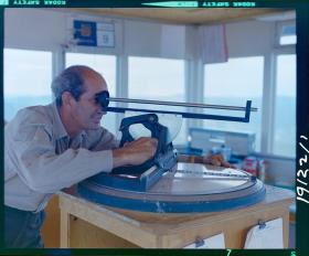 "BC Archives. Item NA-27739. ""Forest Service Terrace lookout ranger using firefinder."""